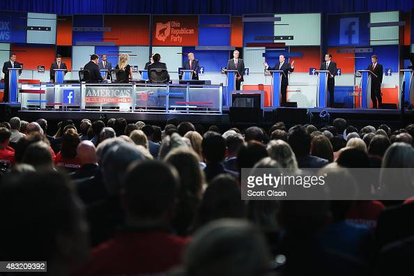 Guests watch Republican presidential candidates speak during the first Republican presidential debate hosted by Fox News and Facebook at the Quicken...