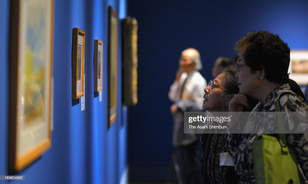 Guests watch the artworks of British artist Joseph Mallord William Turner during the preview of the 'Turner from the Tate: the Making of a Master' at Tokyo Metropolitan Art Museum on October 7, 2013 in Tokyo, Japan. The exhibition will open from October 8 to December 18.