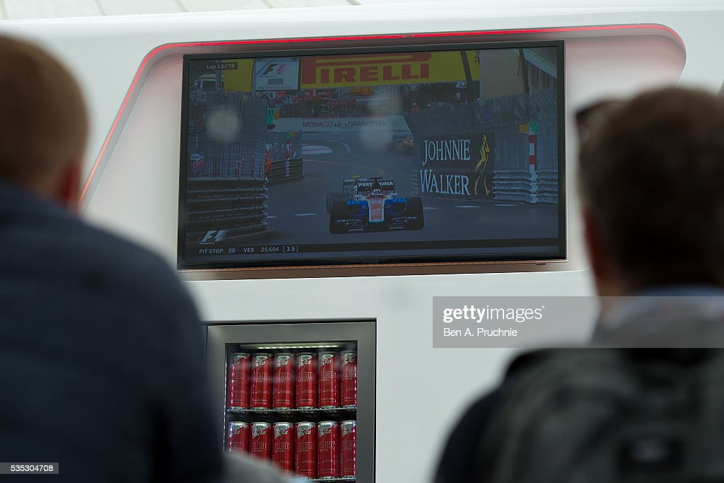 Guests watch the Monaco Grand Prix at the Red Bull Racing Energy Station at Monte Carlo on May 29, 2016 in Monaco.