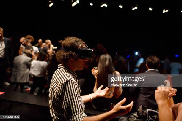 Guests wear VR glasses at the Arzu Kaprol show during MercedesBenz Istanbul Fashion Week September 2017 at Zorlu Center on September 14 2017 in...
