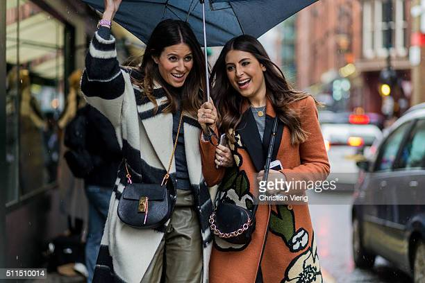 Guests wearing a Chloe bag and a By Malene Birger coat under an umbrella seen outside Holly Fulton during London Fashion Week Autumn/Winter 2016/17...