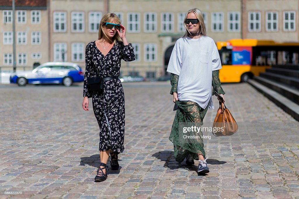 Guests wearing a Loewe bag outside T.A.C. during the first day of the Copenhagen Fashion Week Spring/Summer 2017 on August 10, 2016 in Copenhagen, Denmark.