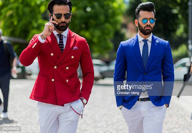 Guests wearing a red and blue blazer and white pants during Pitti Uomo 90 on June 15 in Florence Italy