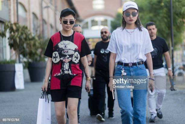 Guests wearing Balenciaga cap is seen outside Malibu 1992 during Milan Men's Fashion Week Spring/Summer 2018 on June 19 2017 in Milan Italy