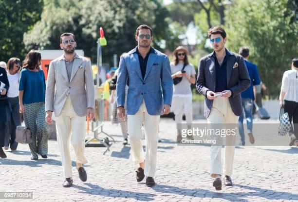 Guests wearing beige pants grey blazer light blue blazer and navy blazer seen during Pitti Immagine Uomo 92 at Fortezza Da Basso on June 13 2017 in...