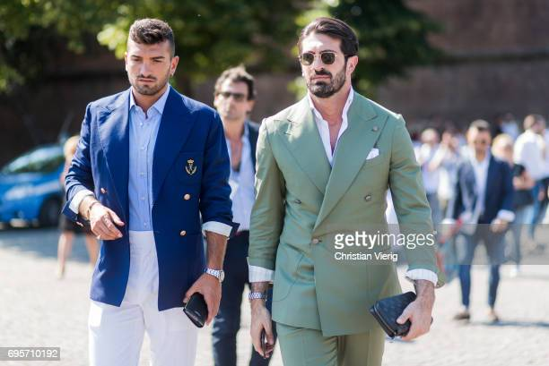 Guests wearing blue jacket green suit is seen during Pitti Immagine Uomo 92 at Fortezza Da Basso on June 13 2017 in Florence Italy