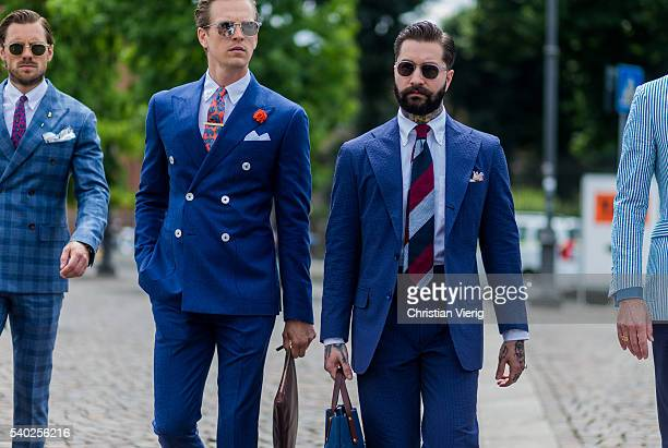 Guests wearing blue suits during Pitti Uomo 90 on June 14 in Florence Italy