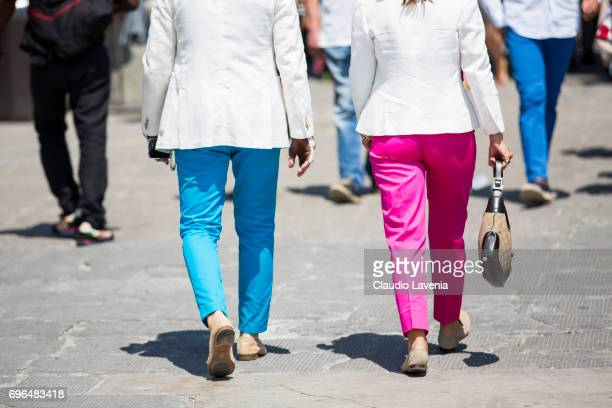 Guests wearing fluocolor pants during Pitti Immagine Uomo 92 at Fortezza Da Basso on June 15 2017 in Florence Italy
