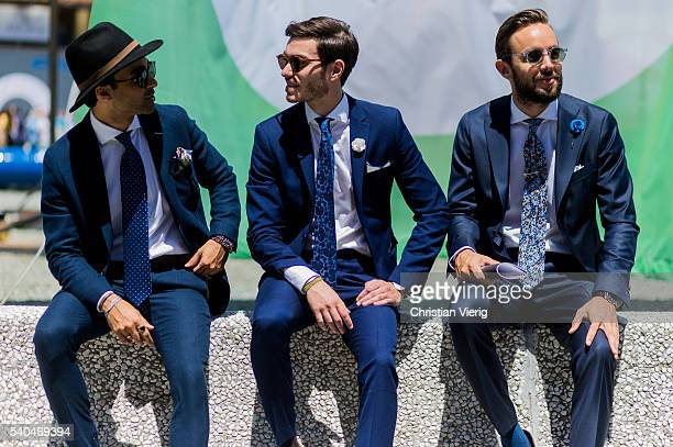 Guests wearing navy suits during Pitti Uomo 90 on June 15 in Florence Italy