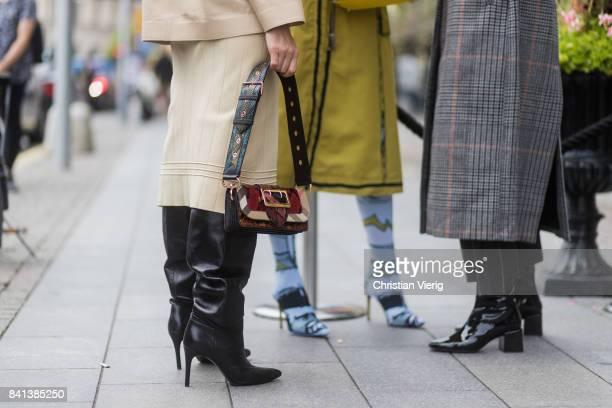Guests wearing overknees boots outside Jennifer Bloom on August 31 2017 in Stockholm Sweden