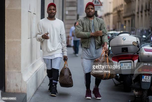 Guests wearing red cap Louis Vuitton weekender bag outside OAMC during Paris Fashion Week Menswear Spring/Summer 2018 on June 21 2017 in Paris France