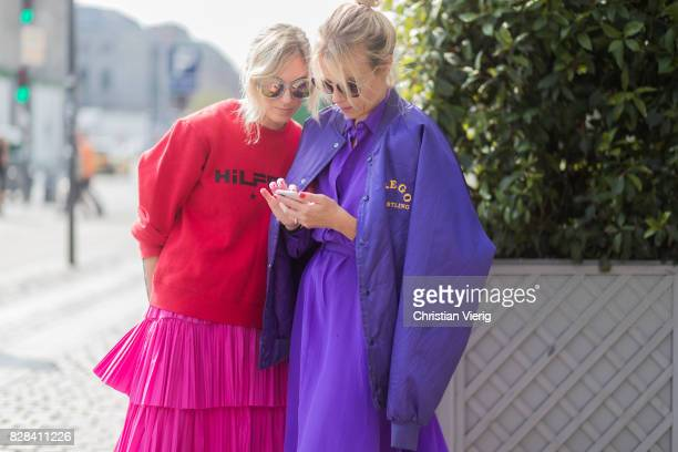Guests wearing red sweater purple dress and jacket on August 09 2017 in Copenhagen Denmark