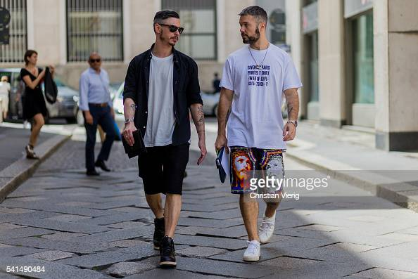 Guests wearing shorts outside Ferragamo during the Milan Men's Fashion Week Spring/Summer 2017 on June 19 2016 in Milan Italy