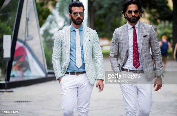 Guests wearing striped blazer jacket checked blazer jacket white pants is seen during Pitti Immagine Uomo 92 at Fortezza Da Basso on June 15 2017 in...