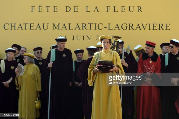 CORRECTION Guests wearing traditional costumes attend the 65th 'Fete de la Fleur' at Chateau MalarticLagraviere in Leognan southwestern France on...