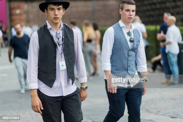 Guests wearing vests is seen during Pitti Immagine Uomo 92 at Fortezza Da Basso on June 15 2017 in Florence Italy