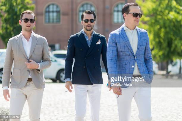 Guests wearing white pants navy and blue blazer jacket pocket square is seen during Pitti Immagine Uomo 92 at Fortezza Da Basso on June 13 2017 in...