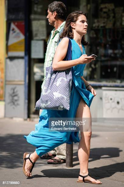 A guestw ears a blue dress outside the Y/Project show during Paris Fashion Week Menswear Spring/Summer 2018 on June 21 2017 in Paris France