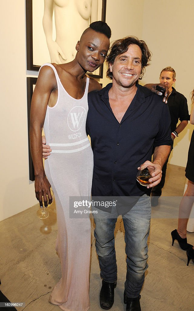 Guetcha and Samuel Bayer attend the Samuel Bayer Ace Gallery Exhibit Opening, presented by Panavision at Ace Gallery on March 2, 2013 in Beverly Hills, California.