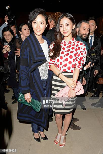 Guey LunMei and Angelababy attend the front row at Burberry Womenswear Autumn/Winter 2014 at Kensington Gardens on February 17 2014 in London England