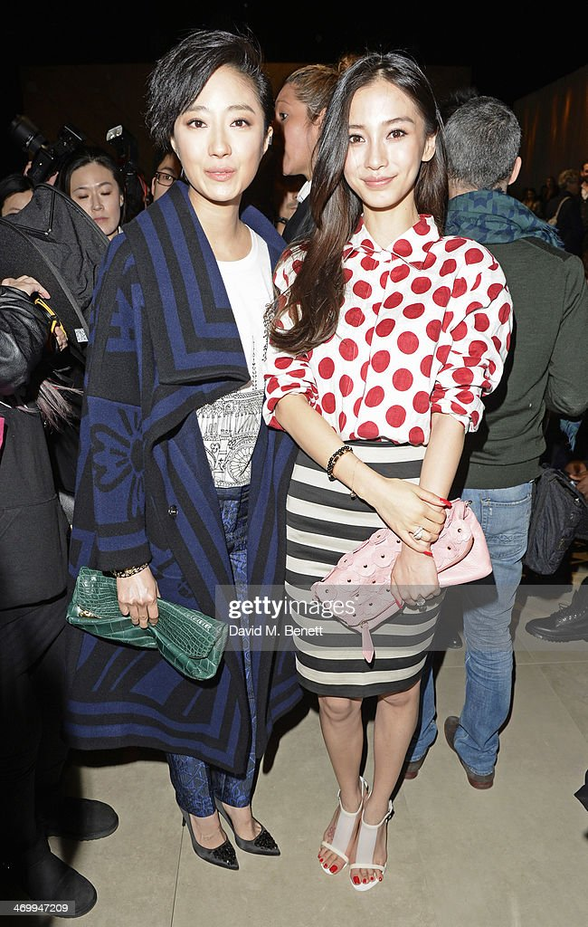 Guey Lun-Mei (L) and <a gi-track='captionPersonalityLinkClicked' href=/galleries/search?phrase=Angelababy&family=editorial&specificpeople=5922162 ng-click='$event.stopPropagation()'>Angelababy</a> attend the front row at Burberry Womenswear Autumn/Winter 2014 at Kensington Gardens on February 17, 2014 in London, England.