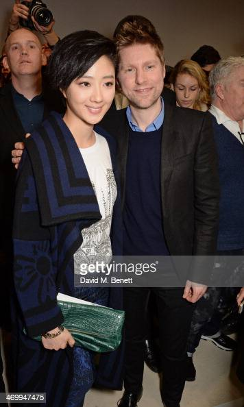 Guey LunMei and Christopher Bailey pose backstage after the Burberry Womenswear Autumn/Winter 2014 show at Kensington Gardens on February 17 2014 in...