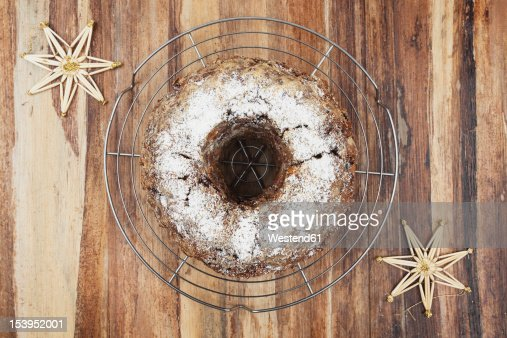 Gugelhupf cake on cooling rack with straw star, close up