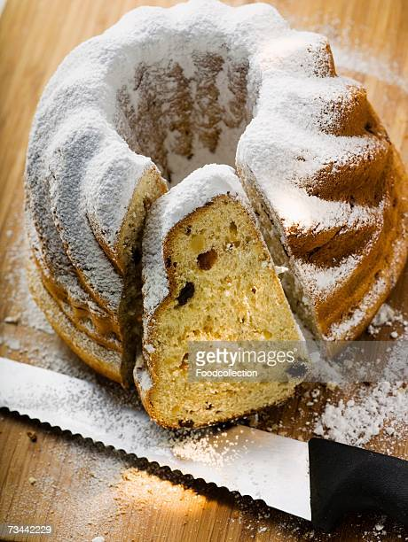 Gugelhupf with icing sugar, partly sliced