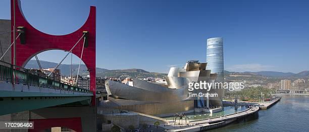Guggenheim Museum by Frank Gehry Red Bridge Principes de Espana Bridge Iberdrola Tower River Nervion at Bilbao Spain