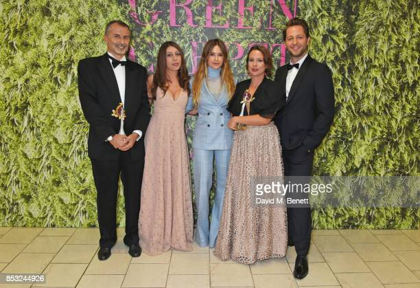 Guglielmo Fiocchi Adriana Santanocito Miroslava Duma Enrica Arena and Derek Blasberg pose backstage with the Technology and Innovation award given to...