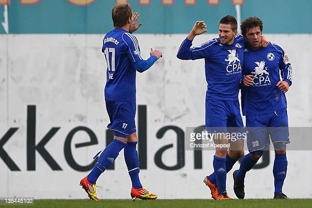 Guglielmo Maddente of Sportfreunde Lotte celebrates the first goal with Martin Hess and Christian Schloesser of Sportfreunde Lotte during the...