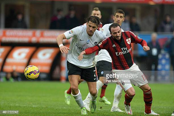 Guglielmo Stendardo of Atalanta BC competes for the ball with Giampaolo Pazzini f AC Milan in action during the Serie A match between AC Milan and...