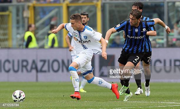 Guglielmo Stendardo of Atalanta competes for the ball with Piotr Zielinsky of Empoli during the Serie A match between Atalanta BC and Empoli FC at...