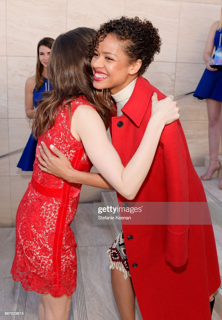 Gugu Mbatha-Raw (R) and Lily Collins at The Hollywood Reporter's 26th Annual Women In Entertainment Breakfast presented in partnership with FIJI Water at Milk Studios on December 6, 2017 in Los Angeles, California.