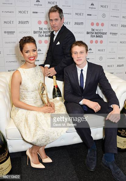 Gugu MbathaRaw winner of the Best Actress award for 'Belle' and presenters Tom Hollander and George Mackay pose at The Moet British Independent Film...