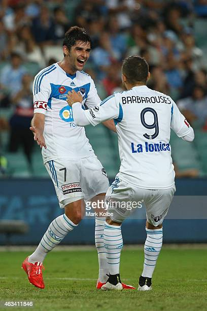 Gui Finkler of Melbourne Victory celebrates with Kosta Barbarouses after scoring a goal during the round 17 ALeague match between Sydney FC and...