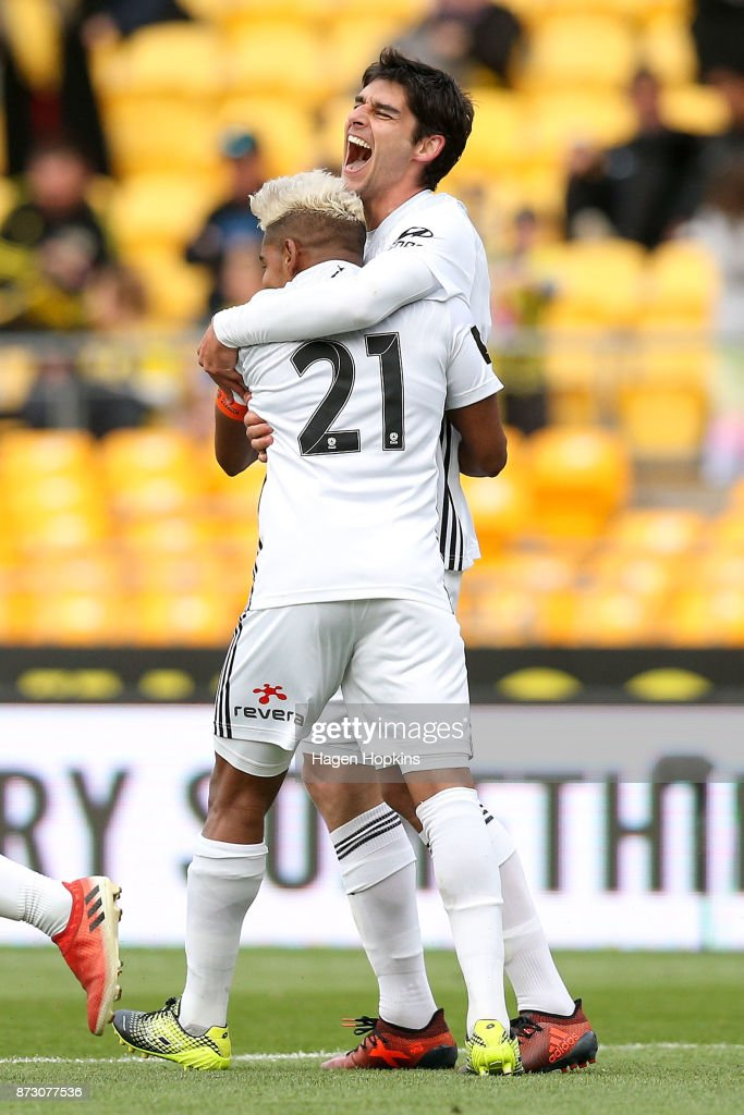 Gui Finkler of the Phoenix celebrates with Roy Krishna after scoring a goal during the round six A-League match between the Wellington Phoenix and the Perth Glory at Westpac Stadium on November 12, 2017 in Wellington, New Zealand.