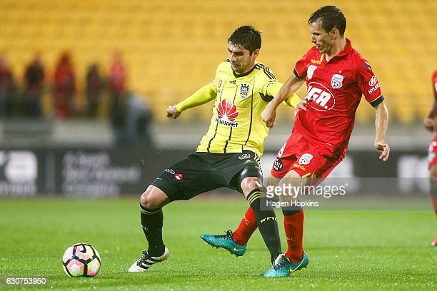 Gui Finkler of the Phoenix holds off the defence of Isaias of Adelaide United during the round 13 ALeague match between Wellington Phoenix and...