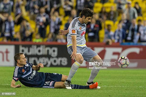 Gui Finkler of the Wellington Phoenix and Alan Baro of Melbourne Victory contest the ball during the 4th round of the Hyundai ALeague between...