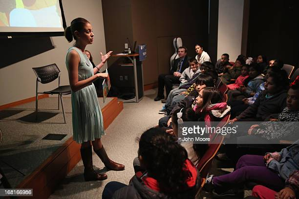 Guidance counselor and author Karina Medina speaks to children from the Brooklyn and Queens boroughs during an immigration workshop at the Museum of...