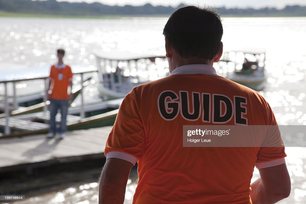 Guide during boat excursion on Amazon river : Stock Photo