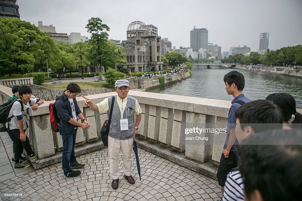 A guide from a survivors' group talks about the bombing across from the A-bomb dome on May 26, 2016 in Hiroshima, Japan. On May 27, President Barack Obama is scheduled to visit Hiroshima, which will be the first time a U.S. president makes an official visit to the site where an atomic bomb was dropped at the end of World War II.