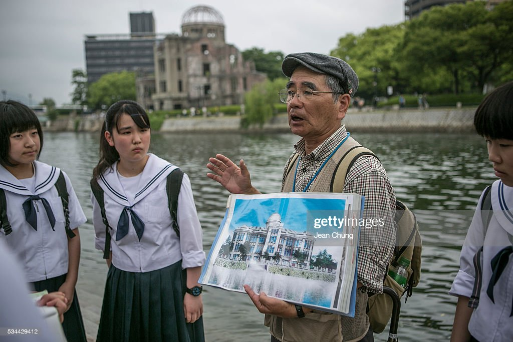 A guide from the survivors group shows an old picture of the Atomic Bomb Dome to middle school students on May 26, 2016 in Hiroshima, Japan. On May 27, President Barack Obama is scheduled to visit Hiroshima, which will be the first time a U.S. president makes an official visit to the site where an atomic bomb was dropped at the end of World War II.