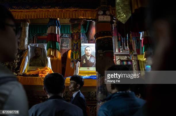 Guide introduce ten Panchen Lama of PanchenErdiniChokyiGyaltsen in the courtyard of the Kumbum Monastery on April 23 2017 in Xining Qinghai Province...