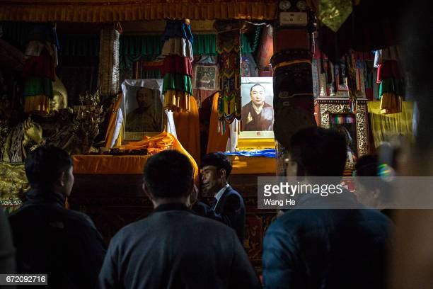 Guide introduces ten Panchen Lama of PanchenErdiniChokyiGyaltsen in the courtyard of the Kumbum Monastery on April 23 2017 in Xining Qinghai Province...