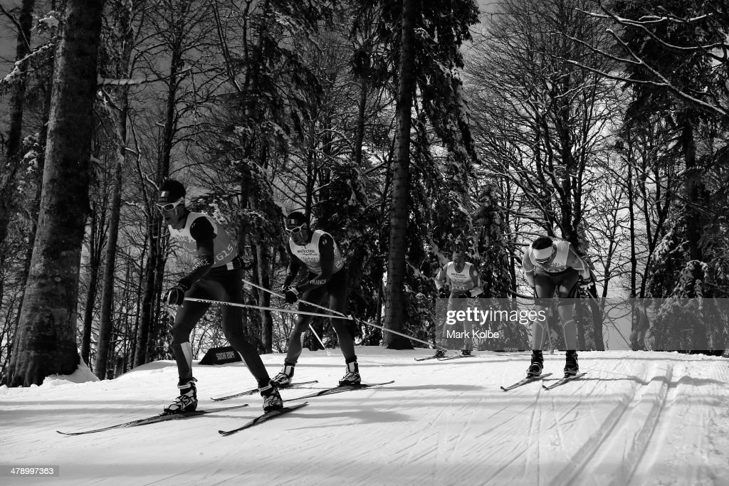 Guide Julien Bourla leads Thomas Clarion of France as they compete in the 4 x 2.5km Open Relay cross-country on day eight of the Sochi 2014 Paralympic Winter Games at Laura Cross-country Ski & Biathlon Center on March 15, 2014 in Sochi, Russia.