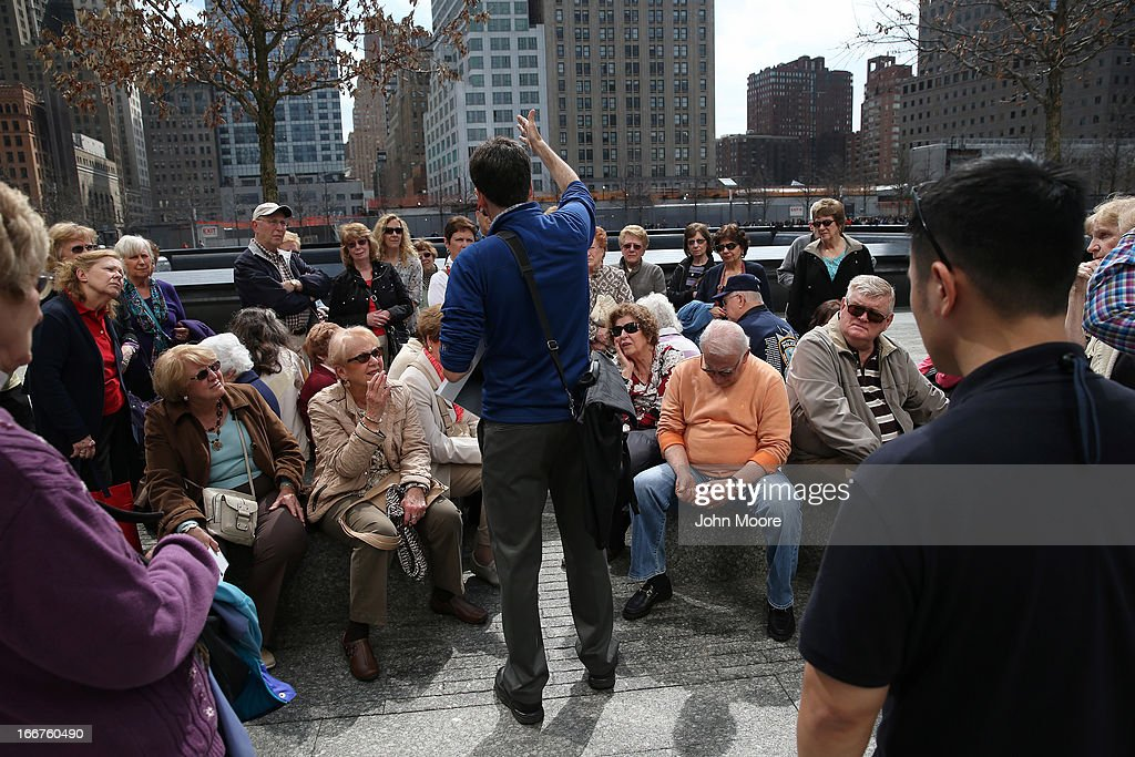 A guide leads a tour group of seniors through the September 11 Memorial and Museum on April 16, 2013 in New York City. Security was high throughout New York City a day after the Boston Marathon attacks.