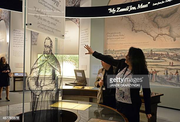 A guide presents a display at an exhibition in the Museum of the History of Polish Jews in Warsaw on October 21 2014 The Museum of the History of...