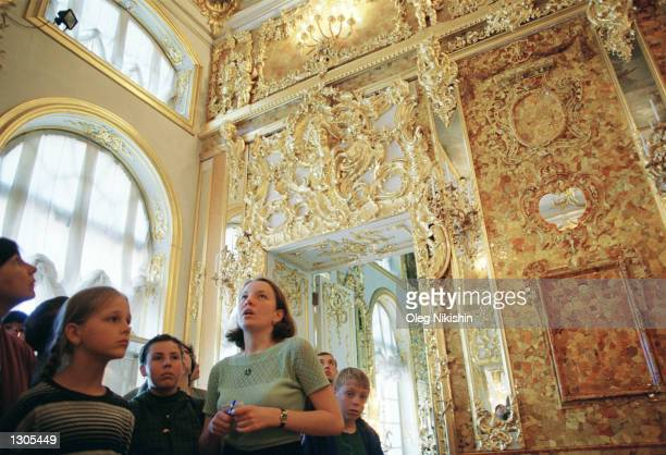 A guide tells tourists about the famous amber room July 10 2000 in St Catherine''s Palace in Tsarskoye Selo near St Petersburg Russia Kaliningrad''s...