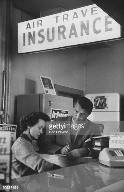 Guided missile expert Dr Wernher Von Braun buying air travel insurance at the airport